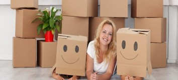 Happy people having fun in a new home with cardboard boxes and a plant; Shutterstock ID 84129238; PO: 1