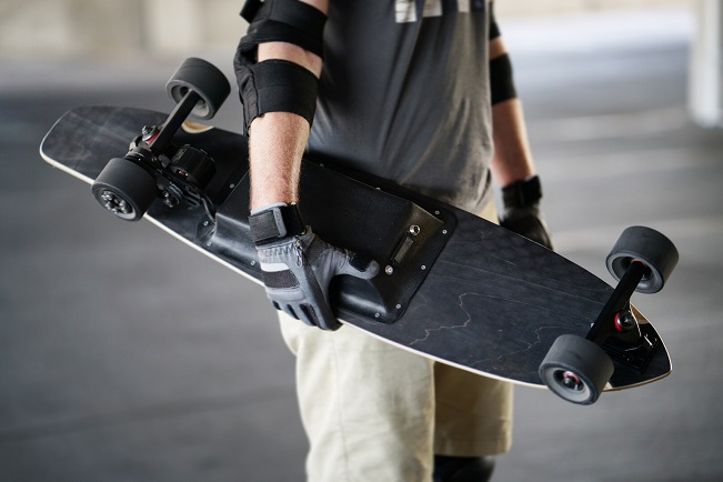 guy holding e-board