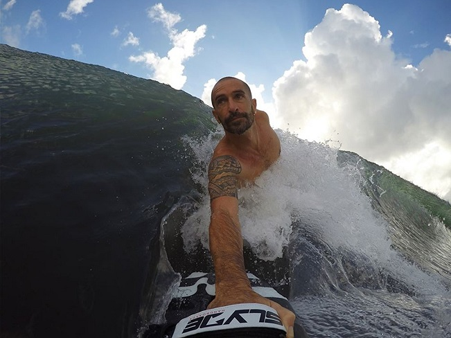 guy surfing with handboard