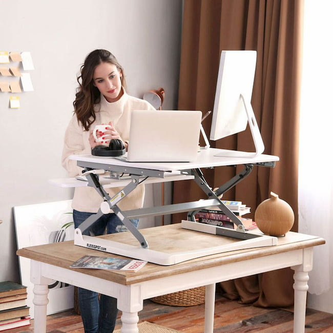 girl working on a sit stand desk