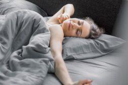 girl sleeping on bamboo sheets
