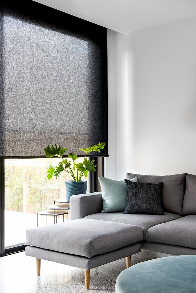 roller modern blinds for living room with grey soga bed and side tables