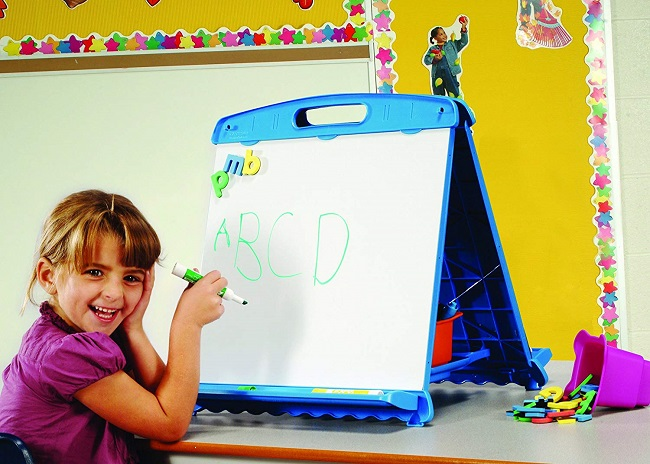 Kid drawing on magnetic board