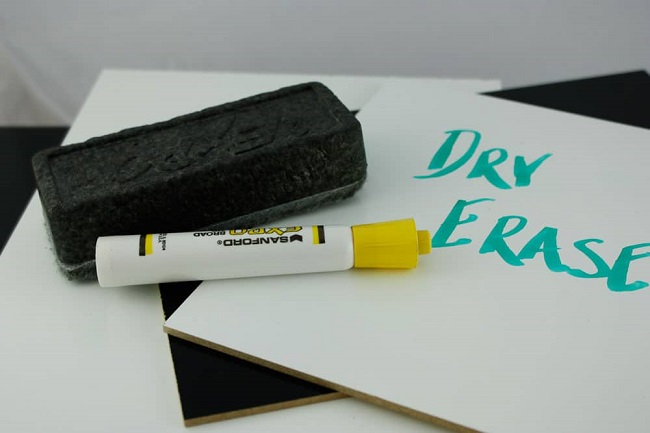 close-up of dry board marker and eraser
