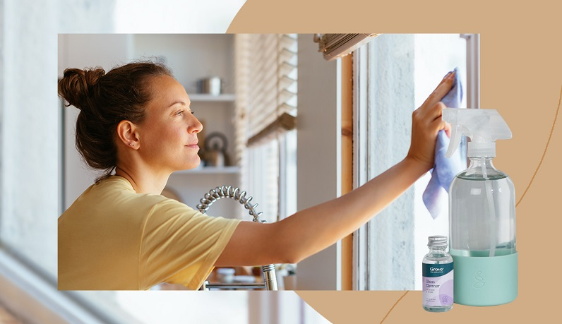 woman cleaning windows with eco products