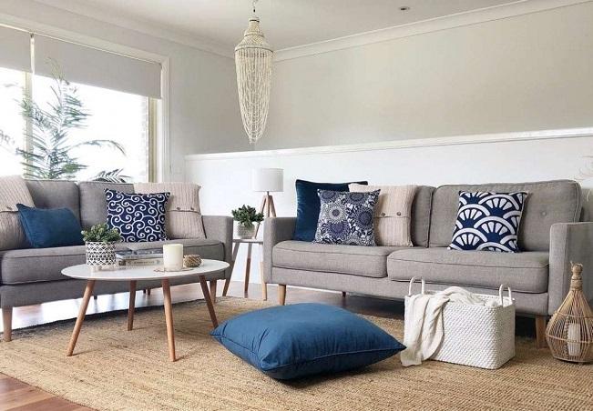 Blue decorative cushions on sofa