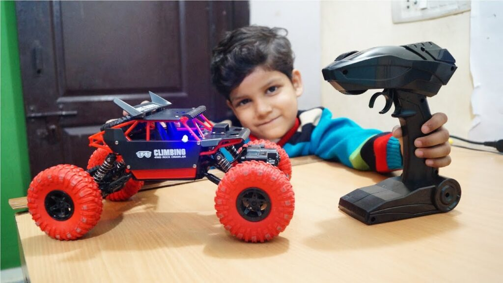 kid play with rc rock crawler