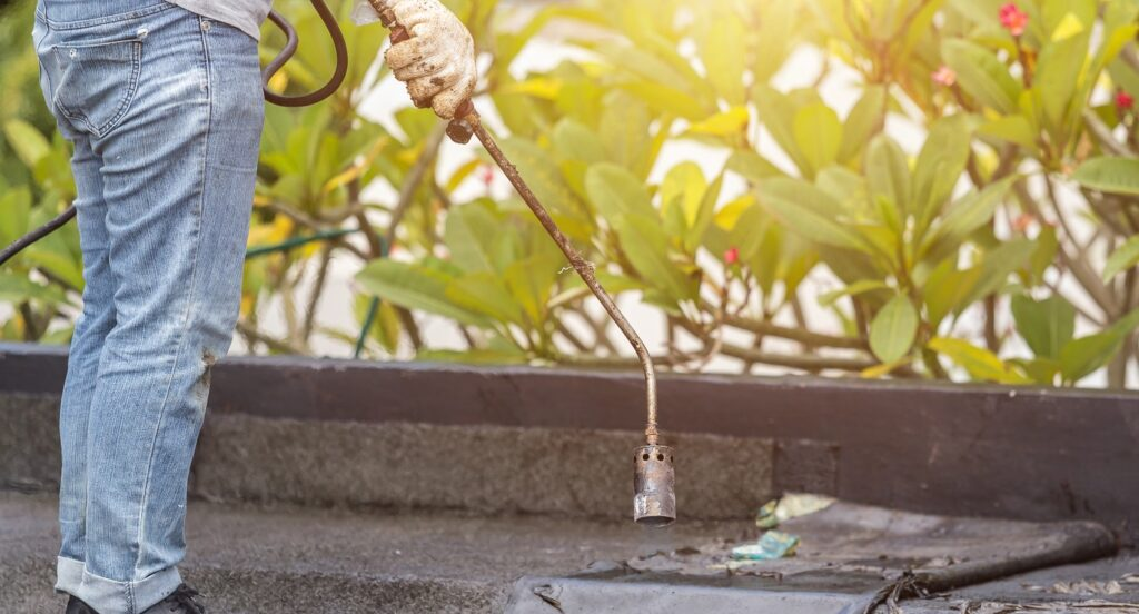 worker use weed torch for burning plants