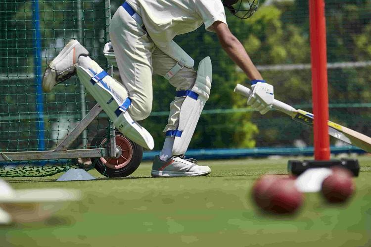 man wearing cricket pads