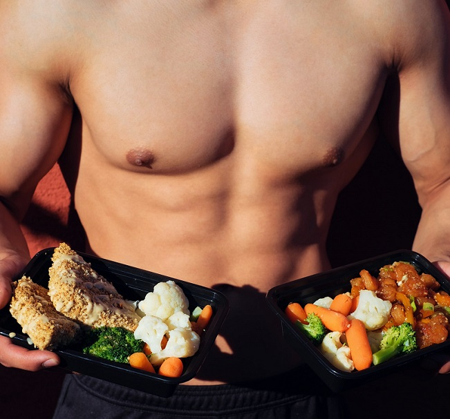 picture of a man holding two portions of healthy food