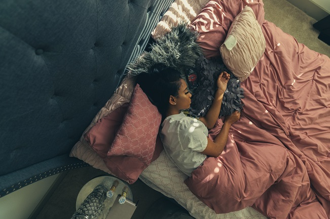 picture of a girl in a in a big bed